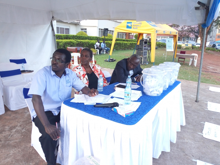 On the left is the Returning Officer Mr Paddy Mugambe, Middle the Chair Dr. Elizabeth Lwanga and on the right is Director of Finance Mr Nakabago John